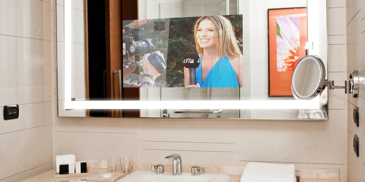 Double Sink Mirrorvue Framed TV installed in a hotel bathroom